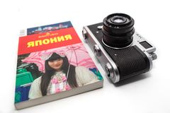 Vintage photo camera on the white background. Retro photo camera close up. 12.02.2018, Moscow, Russia. Concept of journey around Japan with vintage photo camera stock photos