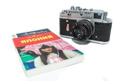 Vintage photo camera on the white background. Retro photo camera close up. 12.02.2018, Moscow, Russia. Concept of journey around Japan with vintage photo camera stock photography