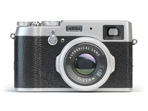 Vintage photo camera  on white. Royalty Free Stock Images