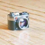 Vintage photo camera on wood surface Royalty Free Stock Photos