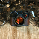 Vintage photo camera on wood table against the background of film. 3D render . Front version royalty free illustration
