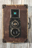 Vintage photo camera on wooden background Royalty Free Stock Image