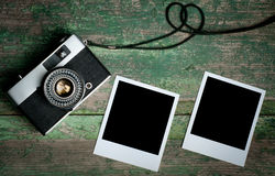 Vintage photo camera on a wooden table Stock Photos