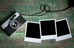 Vintage photo camera on a wooden table Royalty Free Stock Photos