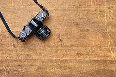 Vintage photo camera on a wooden table. Concept of vintage photo camera  on a wooden table background Stock Photo