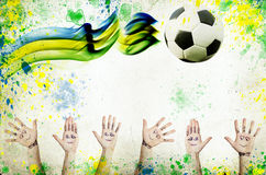 Vintage photo of cheering hands, soccer ball and the Brazil flag Royalty Free Stock Photo