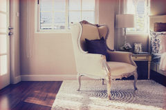 Vintage photo of classic chair with brown pillow Stock Image