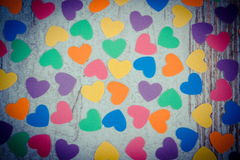 Vintage photo, Colorful hearts of paper for valentines on old wooden background Royalty Free Stock Photo