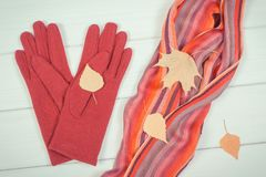 Vintage photo, Womanly gloves and shawl on boards, clothing for autumn or winter. Vintage photo, Colorful womanly shawl and gloves on white boards, warm clothing Stock Image