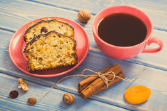 Vintage photo, Cup of coffee and fresh baked fruitcake on boards Stock Photography