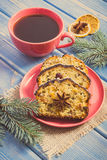 Vintage photo, Cup of coffee, fresh baked fruitcake for Christmas and spruce branches Royalty Free Stock Photos