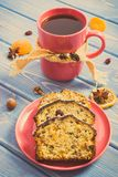 Vintage photo, Cup of tea and fresh baked fruitcake on plate Royalty Free Stock Images