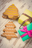 Vintage photo, Decorated gingerbread and gifts for Christmas on old wooden background, christmas time Royalty Free Stock Image