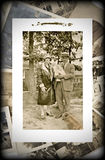 Vintage Photo of Family with Baby. An original vintage photograph of a couple with a baby on a background of old pictures Royalty Free Stock Image
