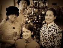 Vintage photo of Family near Christmas tree Royalty Free Stock Image