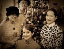 Vintage photo of Family near Christmas tree Royalty Free Stock Image