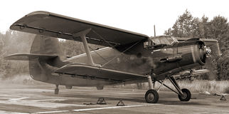 Vintage photo of famous biplane. An-2 Antonov gives full throttle Royalty Free Stock Photos