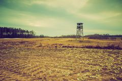 Vintage photo of field with raised hide. Filtered look landscape Royalty Free Stock Photo