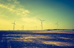 Vintage photo of field with windmills Royalty Free Stock Photography