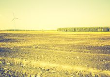 Vintage photo of field with windmills Stock Image
