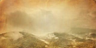 Vintage photo of foggy mountain valley landscape Stock Photos