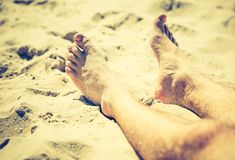 Vintage photo of foot of tanning man Stock Photography
