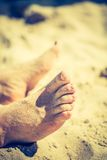 Vintage photo of foot of tanning man Royalty Free Stock Images