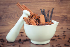 Vintage photo, Fragrant anise, cinnamon and vanilla sticks in mortar Royalty Free Stock Image