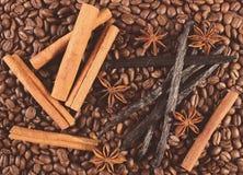 Vintage photo, Fragrant vanilla, cinnamon sticks, star anise on coffee grains Stock Photography