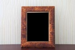 Vintage photo-frame. Vintage photo frame on table Royalty Free Stock Photo