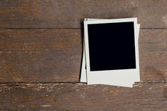 Vintage photo frame blank on old wood background Royalty Free Stock Images