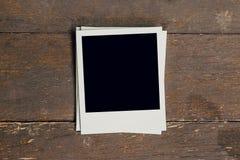 Vintage photo frame blank on old wood background Stock Photos