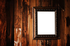 Vintage photo frame on grunge wood wall Stock Photos