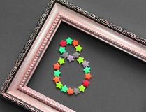 Vintage photo frame. Inside figure eight, laid out from small stars royalty free stock image