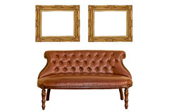 Vintage photo frame and luxurious sofa furniture. Isolated white background Stock Photos