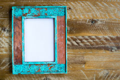 Vintage photo frame over wood background with empty white canvas Stock Photo