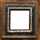 Vintage photo frame over wooden background. With empty space Royalty Free Stock Images