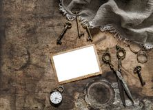 Vintage photo frame scissors keys flat lay. Vintage photo frame, scissors, keys. Nostalgic flat lay Royalty Free Stock Photography