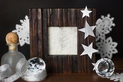Vintage photo frame and silver white christmas decoration on bla Stock Images