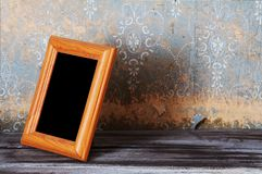Vintage photo-frame on table Stock Images