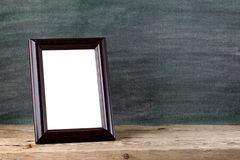 Vintage photo frame. On table Stock Photo