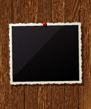 Vintage photo frame on wood. Vintage photo frame pinned on the wooden wall Royalty Free Stock Photos