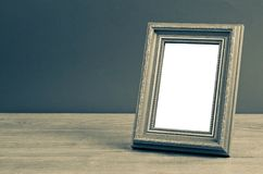 Vintage photo frame on wooden table. Stock Photo