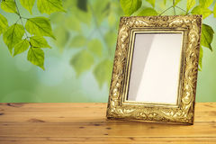 Vintage photo frame on wooden table Royalty Free Stock Image