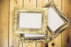 Vintage photo frame on wooden table Stock Images