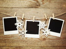 Vintage photo frames decorated for Christmas on the wooden board background with space for your text Stock Image