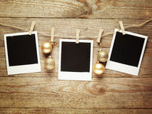 Vintage photo frames decorated for Christmas on the wooden board background with space for your text Royalty Free Stock Images