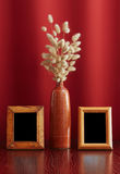 Vintage photo-frames and ikebana Stock Images