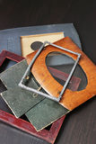 Vintage photo frames. On a wooden background Stock Photo
