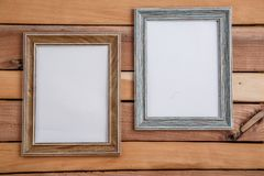 Vintage photo frames on wooden background with space for text and various photos.  stock photography